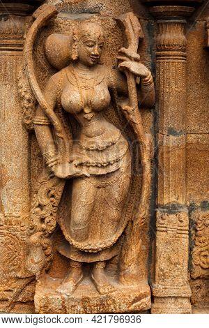 Apsara bas relief in Hindu temple Sri Ranganathaswamy Temple in Tiruchirappalli (Trichy), Tamil Nadu, India