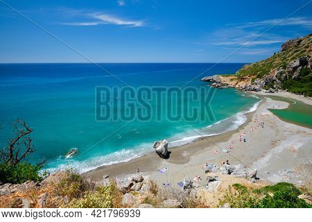 View of Preveli beach on Crete island with relaxing people and Mediterranean sea. Crete island, Greece
