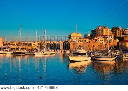 Venetian Fort castle in Heraklion and moored fishing boats, Crete Island, Greece on sunset