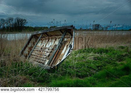 Old Wrecked Boat On The Shore Of The Lake And Storm Clouds, Stankow, Lubelskie, Poland