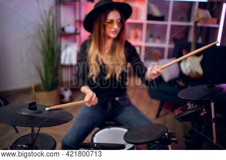 Talented Female Musician Practising In Playing Electronic Drums In Studio. Attractive Woman Rehearsi