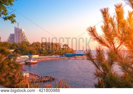 Seascape. On The Seashore, Beautiful Houses And Beaches At Sunset. Travel And Tourism.