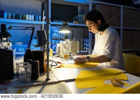 Clothing Production Business: Young Studio Owner Female At Workplace Sew Clothes On Modern Sewing Ma