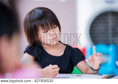 Asian Cute Girl Doing Art On Table. Kid Thinking And Imagination With Craft Workshop. Homeschool Wit