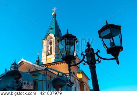 Street Lamp In Front Of The Church  . Cupola And Street Light