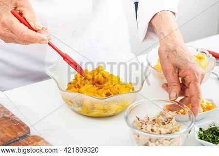 Senior Woman Preparing The Filling For A Traditional Dish From El Valle Del Cauca In Colombia Called
