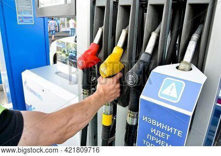 Minsk. Belarus: 13.06.2013 - Gas Station. A Refueling Gun Is In A Blue Cars Fuel Filler Flap.