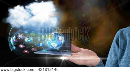 Composition of digital online icons and cloud floating over businesswoman's hand. global technology, digital interface and communication concept digitally generated image.