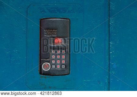An Intercom On Old Painted Blue Steel Surface With A Keypad, Digital Display And Rfid Sensor For Cal