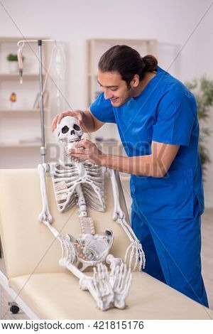 Young male doctor suggesting pills to skeleton patient