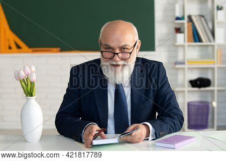 Teacher In The Classroom Is Teaching A Lesson. Professor At The University Is Giving A Lecture. Acad