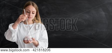 A Scientist Chemist In An Office Near A Chalk Board With A Flask In His Hands Mixes Liquids In A Gla