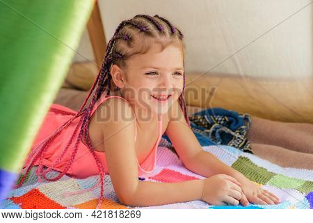 Kid Campgound Concept. Adorable Girl Playing In Tent. Kids Camping. Having Fun Outdoors. Happy Kid I