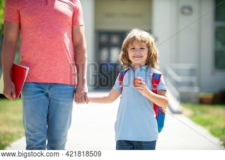 Kid Elementary Student Carrying Backpacks Holding Parent Fathers Hand Walking Up Educational Buildin