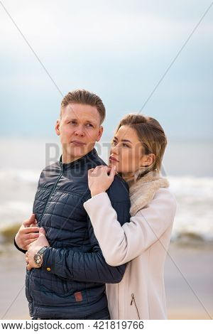 Young Couple Enjoying On A Sand And Enjoying Each Other.summer,spring,autumn Vacation.closeup.