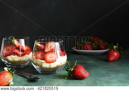 Tiramisu With Strawberries In A Glass On A Dark Stone Background. Dessert With Strawberries.