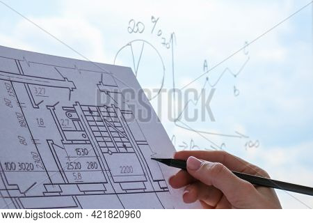 Female Interior Designer Drawing House Plan In Office. Workplace Workspace Window. Architect At Work