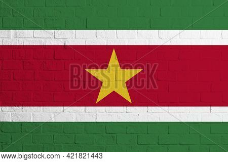 Flag Of Suriname. Brick Wall Texture Of The Flag Of Suriname.
