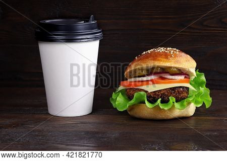 Cheeseburger On A Wooden Background. Hamburger With Cheese. Burger Isolated. Tasty Dinner.copy Space