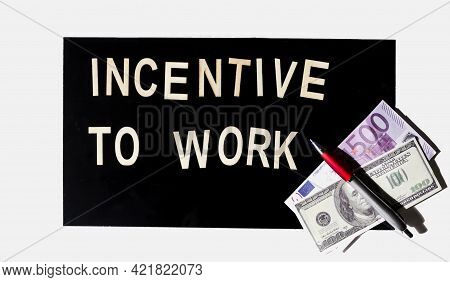 Incentive To Work Text Is Written On A Black Mirror Background In Wooden Letters.