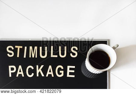 Incentive Package The Word Is Written In Wooden Letters In A Vintage Look, Next To Coffee On A Mirro