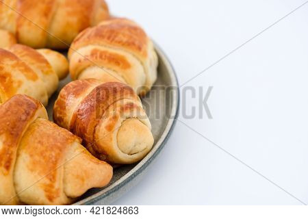 Homemade Delicious Croissants On A Dessert Gray Plate. Tasty Homemade Croissants Cake. Frances Natio