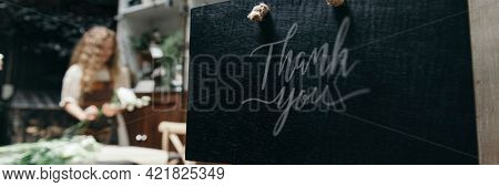 Florist with her shop sign mockup