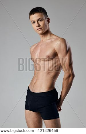 Sporty Man In Black Shorts On Nude Body Gray Background Muscle Bodybuilding Fitness