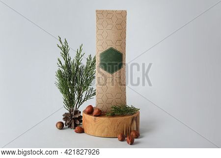Scented Sachet, Hazelnuts And Fir Branches On Grey Background