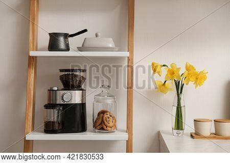 Modern Coffee Grinder On Shelving Unit In Kitchen