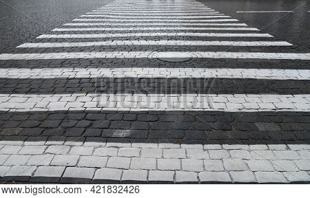 Abstract Background. Old Cobblestone Pavement Closeup And White Line.