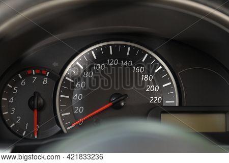 Speedometer And Tachometer On Modern Car Dashboard