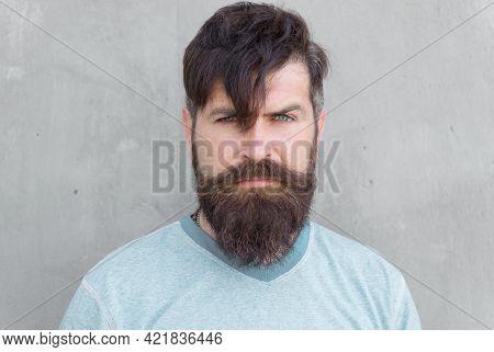 Long Hair. Cut Bangs. Cool Hipster With Beard Need Haircut. Barber Salon And Facial Care. Hipster Li
