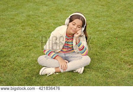 Educational Podcast. Make It Happen. Listen Music While Relaxing Outdoor. Kid Girl Enjoy Music Green