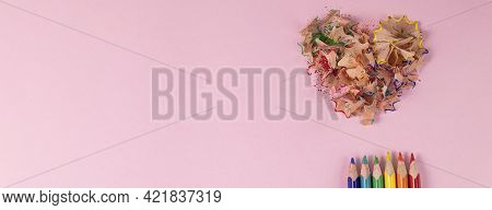 Banner With Top View Of Sharpened Colored Pencils And Heart-shaped Pencil Shavings On Pastel Pink Co