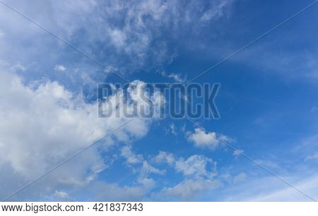 Beautiful White Fluffy Clouds On Vivid Blue Sky In Day Light