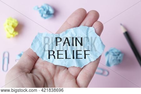 Pain Relief Blue Paper In Hand Of Medical Doctor