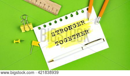 Text Stronger Together Sign Showing On The Green Background With Office Tools