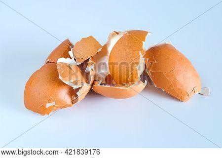 Eggshell Scattered From Egg Boiled On A White Background.