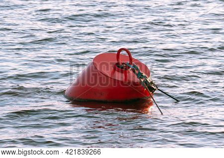 Red Metal Buoy In The Water. High Quality Photo