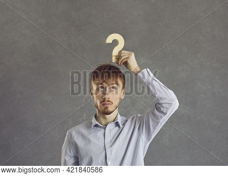 Puzzled Young Beginner Businessman Is Looking For Answers About The Development Of His Business.