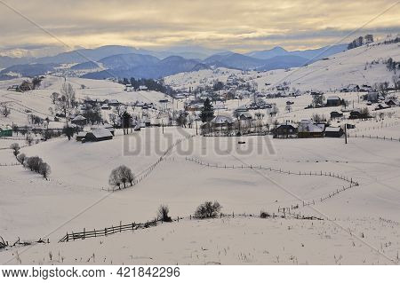 Winter Sunset In Sirnea Village, Brașov Romania