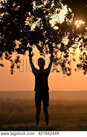 Closeup Portrait Young Man Praying Hands Up Against Sunset