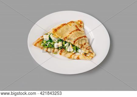Person Eating Crepes With Filling. Tasty Breakfast.