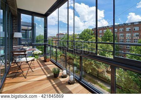 Warsaw Poland - August 7, 2018: Balcony In A Modern Apartment With Furniture, Flowers And City Views