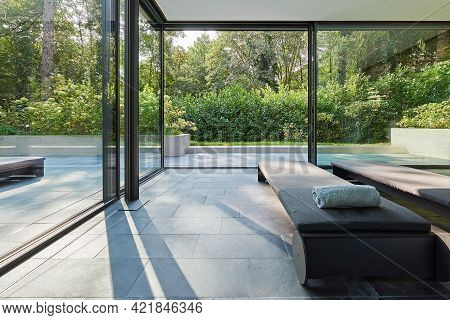 Cologne, Germany - August 4 2020: Modern Villa House Terrace In Garden
