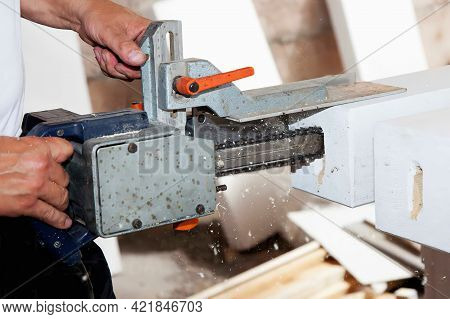 Carpenter Working With Jig Saw And Wood