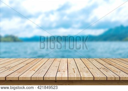 Empty Wooden Table Top On Sea Background, Used For Display Or Montage Your Products
