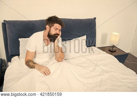 Some More Minutes Sleep Please. Bearded Man Sleep Sitting In Bed. Hipster Take Nap. Early Morning. N