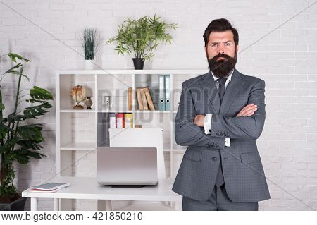Office Manager In Formal Fuit. Serious And Mature Boss At Workplace. Everything In Order And Fits Pe